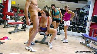 Busty brunette girl gets fucked in a gym in public