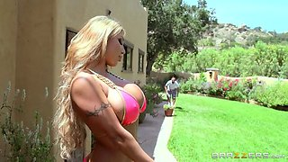 big boobed august taylor teasing in the garden