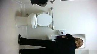 Public toilet spy cam catches woman peeing