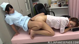 Lesbian nurse and a naughty doctor share a double dildo