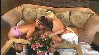 This blonde bride has no problem sharing her fiance's cock with her bestie