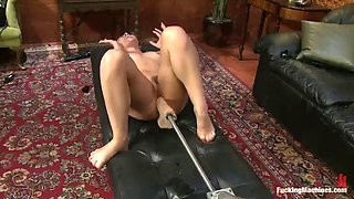 hot babe works up a sweat while using a machine
