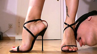 Dominant brunette in high heels gets her sexy feet licked