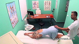 Doctor surprised busty blonde patient