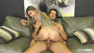Tattooed blonde Karma RX spreads her fine legs for a sexual game