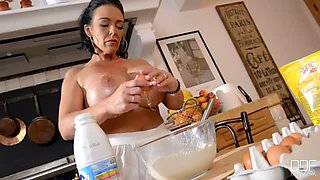 Hot like hell brunette MILF plays with her huge round boobs at kitchen