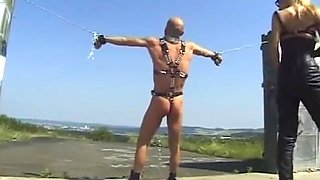 Mistress Punishes Chained Slave Outdoors
