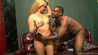 Small tittied gal riding massive black shaft in a cowgirl position