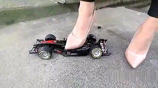 Crushing and destroying a car under high heels