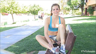 Sporty chick Brina shows her cameltoe and nice butt in a park