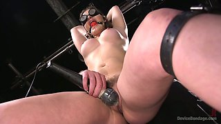 Gagged long haired slut Dani Daniels gets fucked with a sex machine