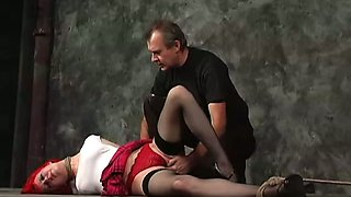 Red haired slut is tied up and punished by horny master