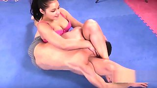 Brunette sexy wrestling puts submissive in holds
