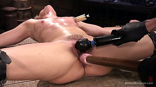 Kinky dude dildo fucks stretched twat of crucified on the floor bitch Helena Locke