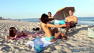 Cute milfs are getting picked up on the beach and brought home for a quickie foursome