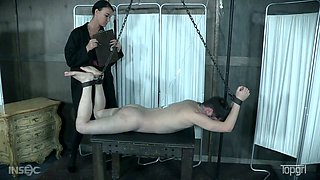 Tattooed skinhead Abigail Dupree is fucked and punished by kinky mistress