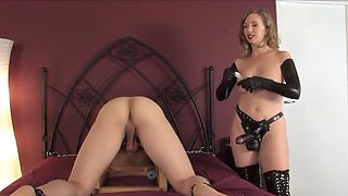mistress plays with cuffed slave