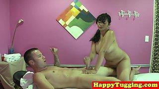 Busty oriental masseuse seducing clients dick