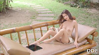 Young small titty beauty poses and plays with her clit