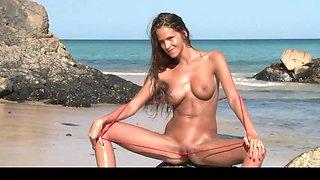 tiny bikini babe on the beach