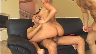 Flexible light haired whore in heels gets analfucked missionary on the couch