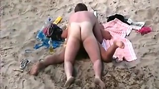 A voyeur tapes swingers having a threesome at a nude beach