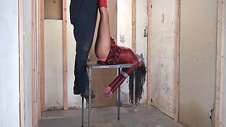 Hanging by her heels