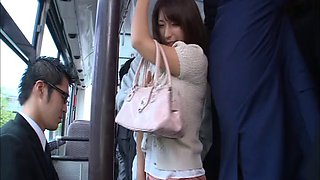 Busty Japanese pornstar gets fondled on the bus before a facial gang banging