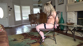 Beautiful blonde tied up and dominated