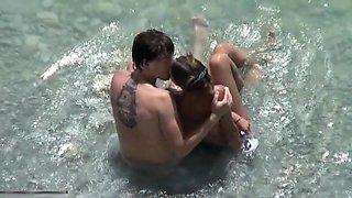 Teenage couple shagging on a beach