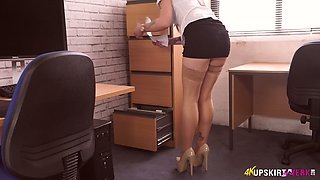 Curvy secretary in stockings Elouise shows her yummy pussy upskirt
