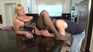 Mature cougar devours young dick