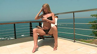 Long legged sexy blonde babe gets rid of her bikini and masturbates outdoors