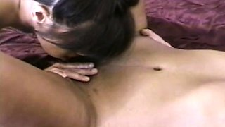 Two alluring Indian girls kiss each other and share a cock on the bed