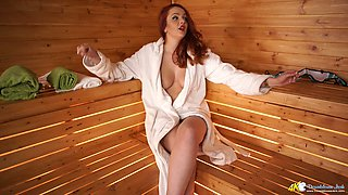 Gorgeous ginger babe Kara Carter is showing her natural tits in the sauna