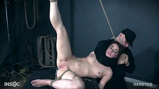 Red haired harlot Kate Kenzi is tied up and punished in the bdsm room