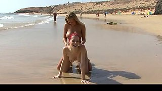 two babes getting naked together on the beach
