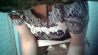 White lady in white panties and nylon pantyhose pisses in the toilet