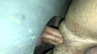 Sucking and fucking a cock in gloryhole
