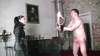 Extreme whipping by leather mistress