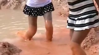 two thai girls in mud
