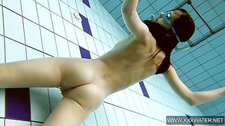 Vera Brass wet and naked in the swimming pool
