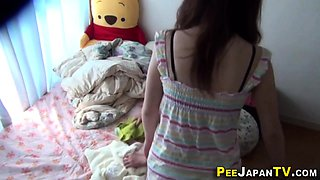 Asian teens piss on bed