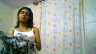 Indian amateur college girl filmed on cam in the bathroom