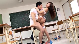 Busty Japanese teacher takes on a gang of raging cocks