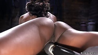 Hairy ebony rides machine in bondage