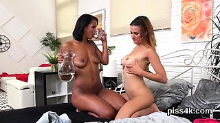 Erotic lesbo cuties get sprayed with piss and blast wet snat
