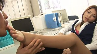 Sexually confident office slut makes her colleague worship her feet and pussy