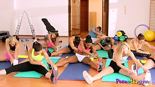 Flexible gym babes stretching in group