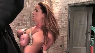 Christina Carter surprised & hanged by bound breasts